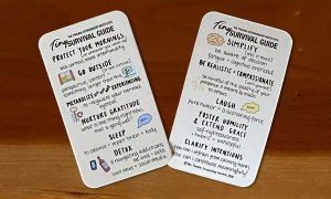 Tiny Survival Guide Wallet Size Card on Wooden Background